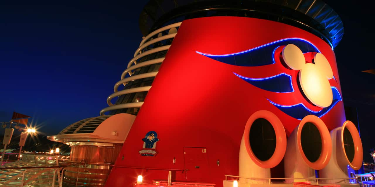 The Forward Funnel with a Mickey Mouse logo on the top deck of the Disney Magic cruise ship