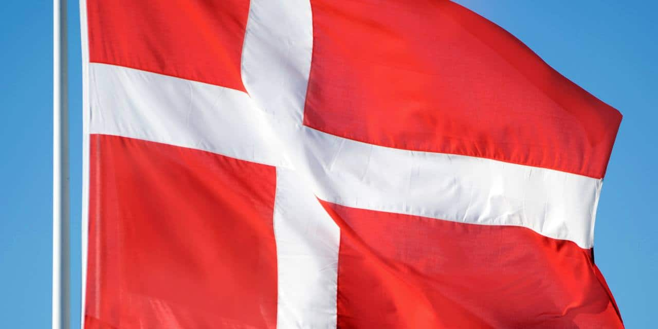 The flag of Denmark flies in the air