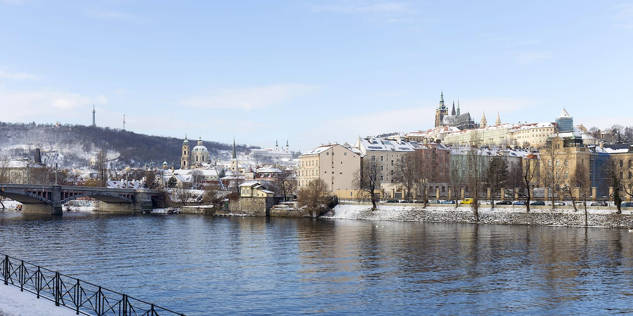 Snow covered buildings and cathedrals of Basel, Switzerland along the banks of the Rhine River