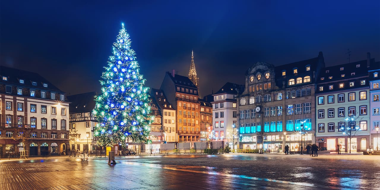 A large Christmas tree lit up in a Strasbourg, France town square