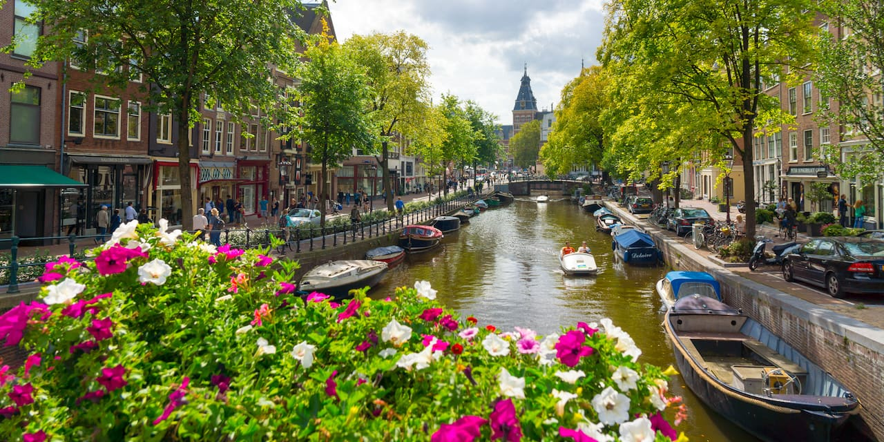Canal in Amsterdam lined with boats and buildings