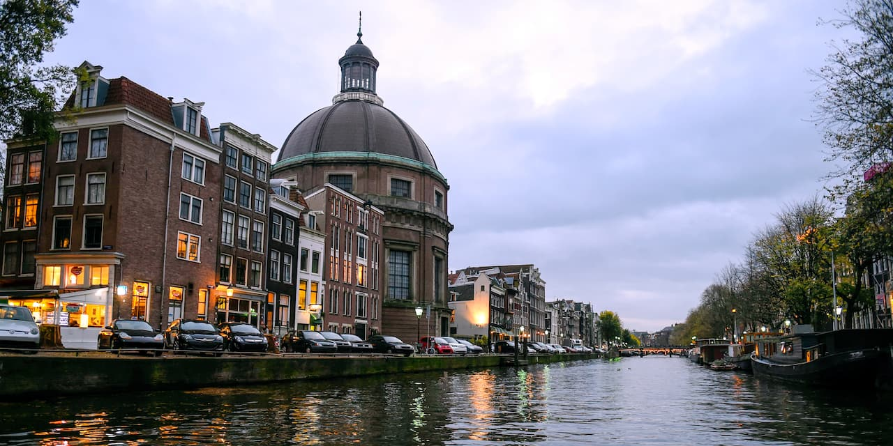 Buildings line the bank of a river