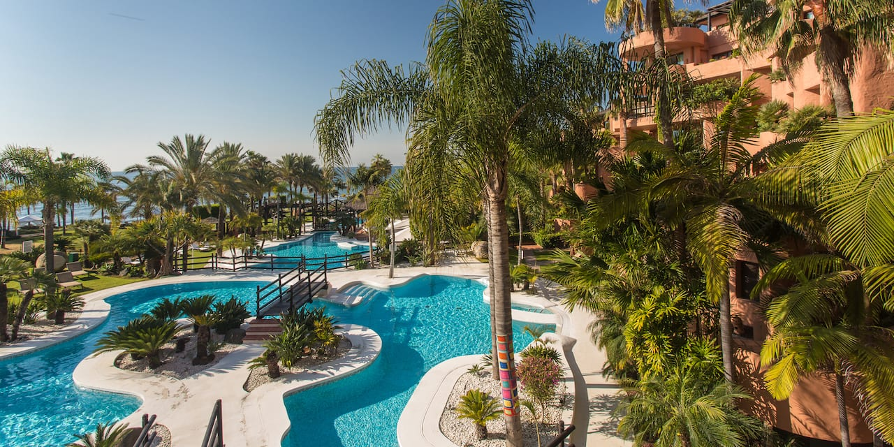 The Kempinski Hotel Bahía overlooks the pool area with its island feature and lush fauna