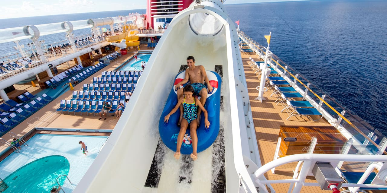 Two Guests ride a boat down the AquaDuck water coaster on the <i>Disney Fantasy</i> cruise ship