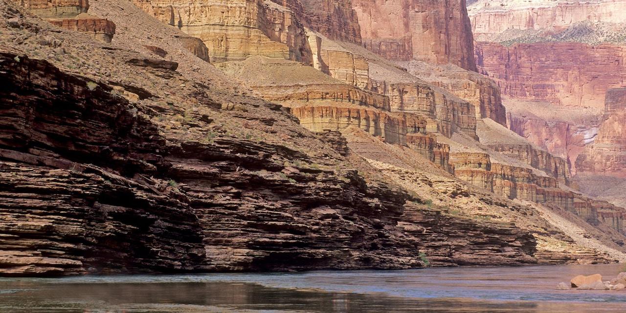 The Colorado River running through a rock canyon