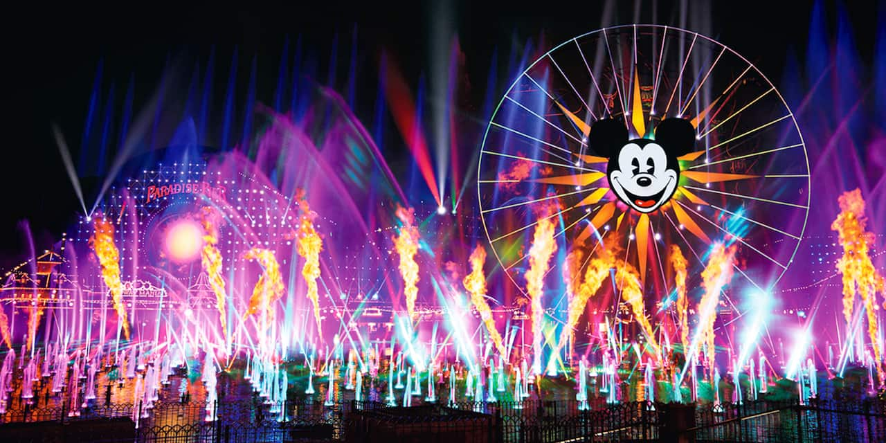 Multicolor lights and fountains with the Pixar-Pal-Around attraction in the background