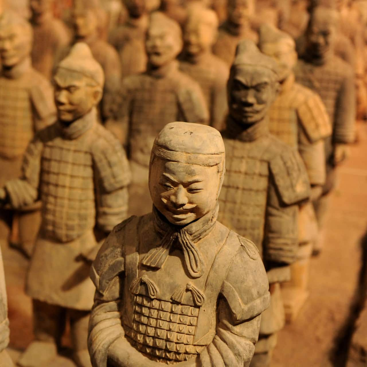 Ancient terracotta sculptures of warriors, standing in formation