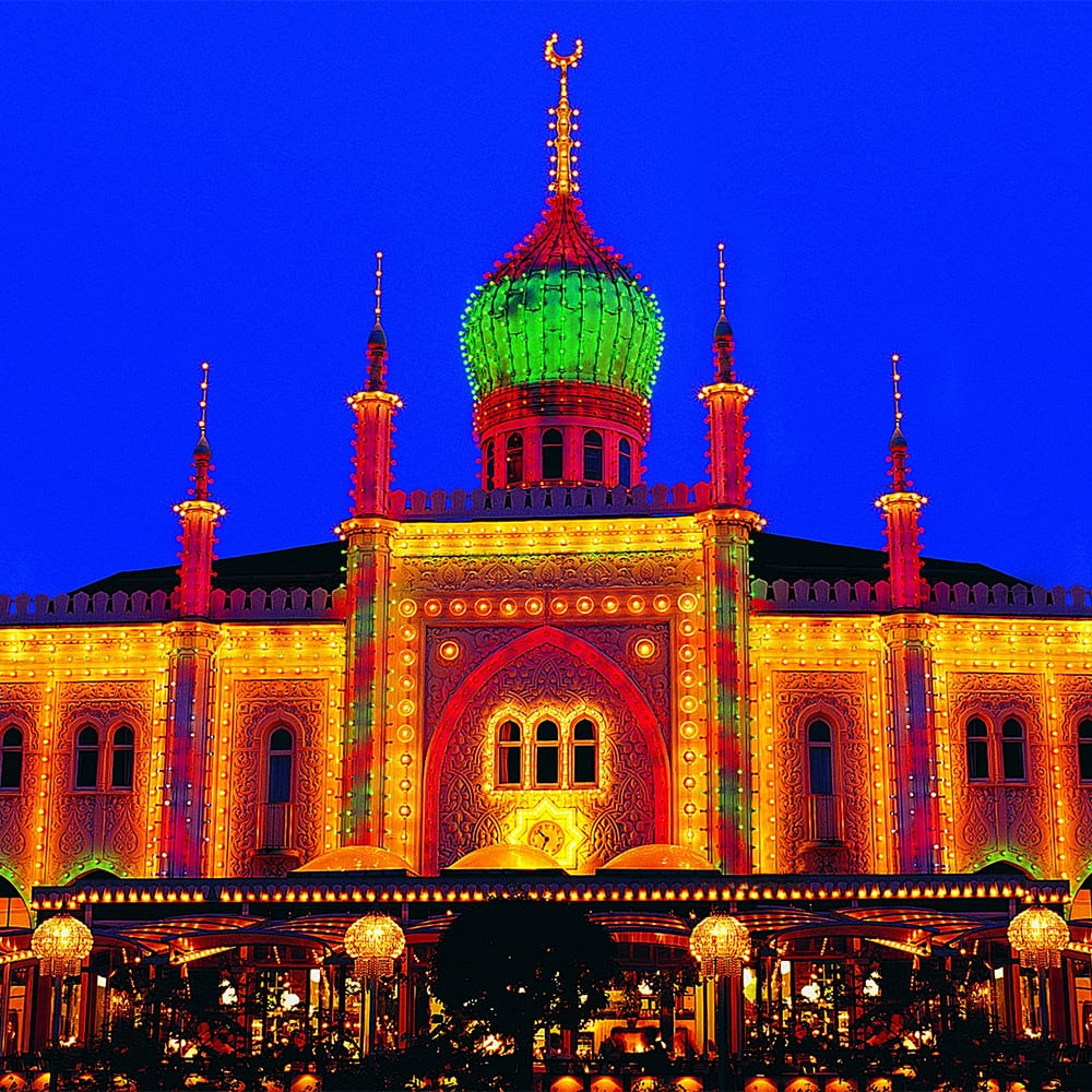 The dramatic entrance to the Tivoli Gardens at night