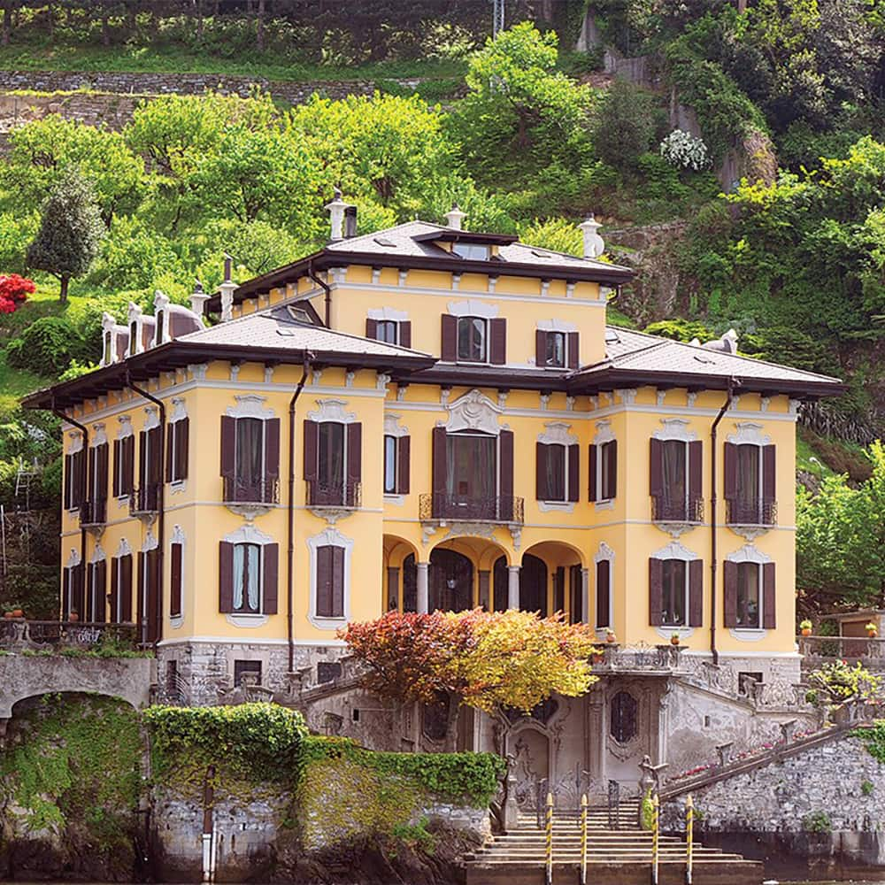 A handsome 3 storied manor house with a tiered garden up the hillside