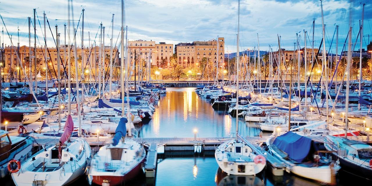 Dozens of boats docked in a Barcelona harbor