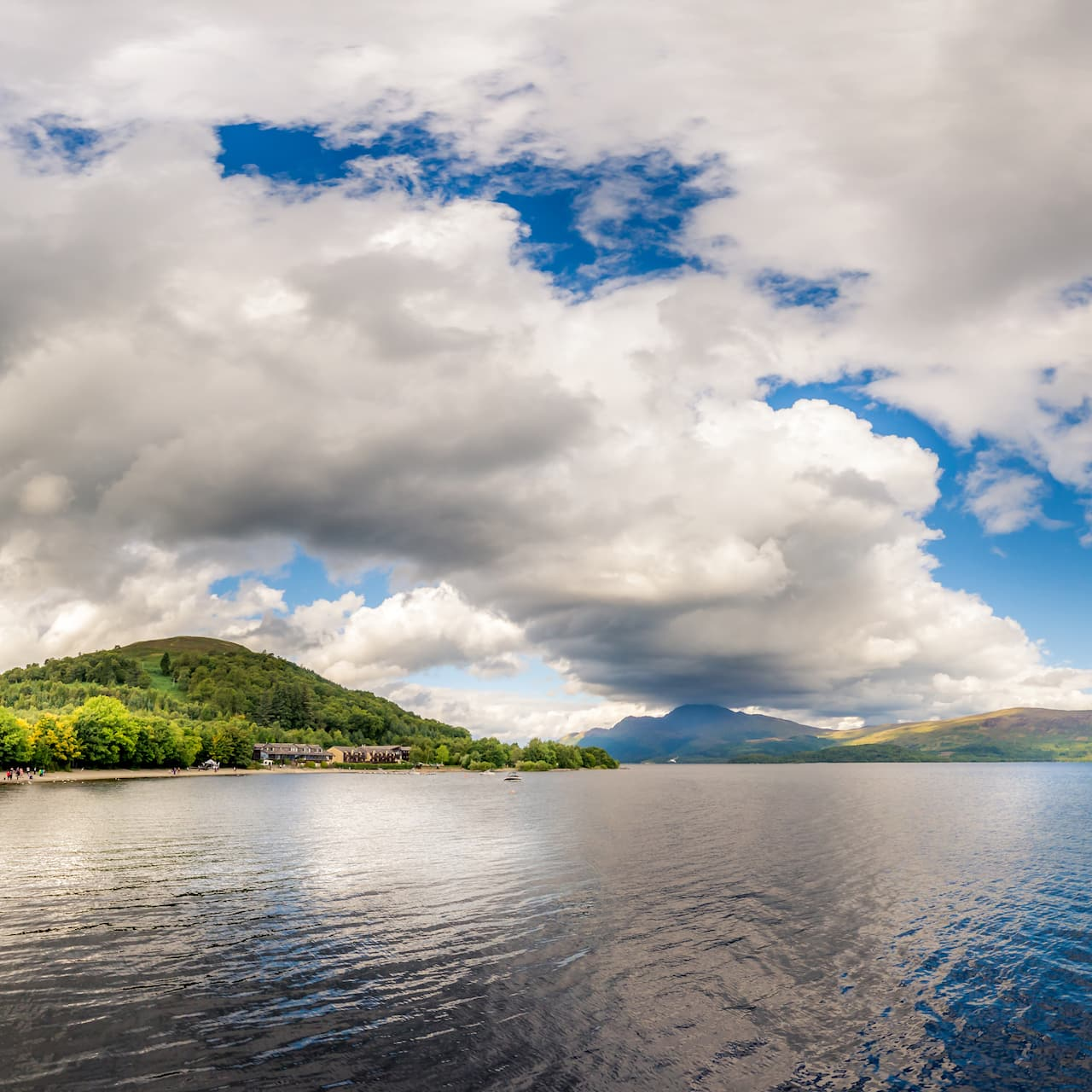 Hills line the shores of Loch Ness on a cloudy day