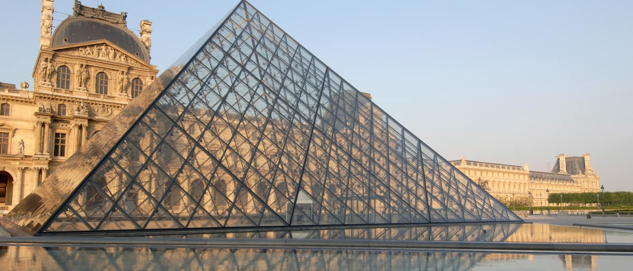 The Louvre Pyramid in front of the Louvre Museum in Paris, France
