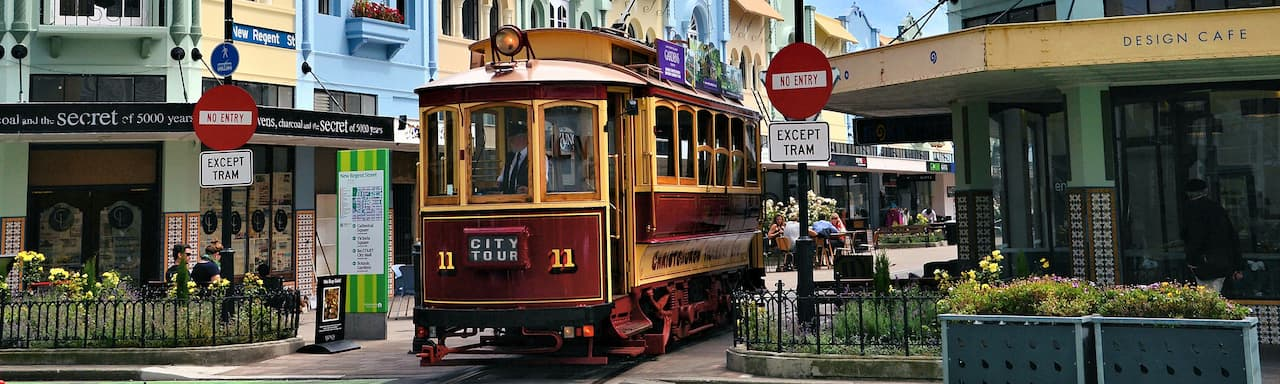 A trolley rides down the middle of Regent Street in Christchurch, New Zealand