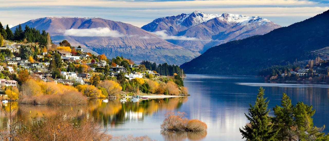 Lake Wakatipu flows past the city of Queenstown towards a distant mountain range