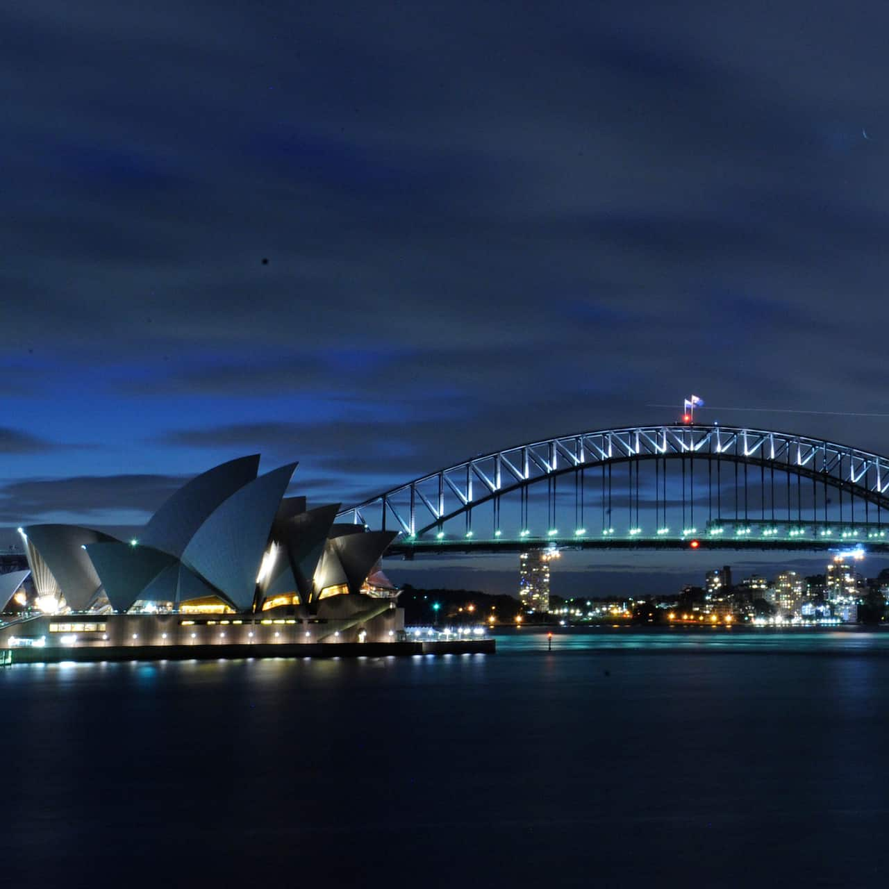 The Sydney Opera House and the Sydney Harbour Bridge at night