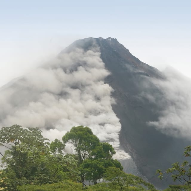 Mist surrounds the crater of the Arenal volcano