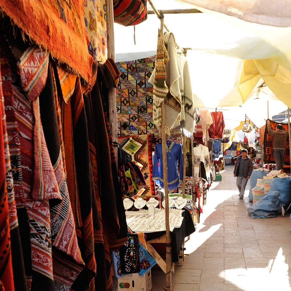 Hand-woven textiles and crafts line the stalls at Pisac Market