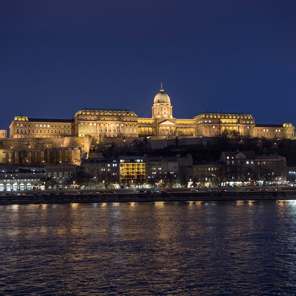 The Danube River with Buda Castle and Castle Hill lit up at night