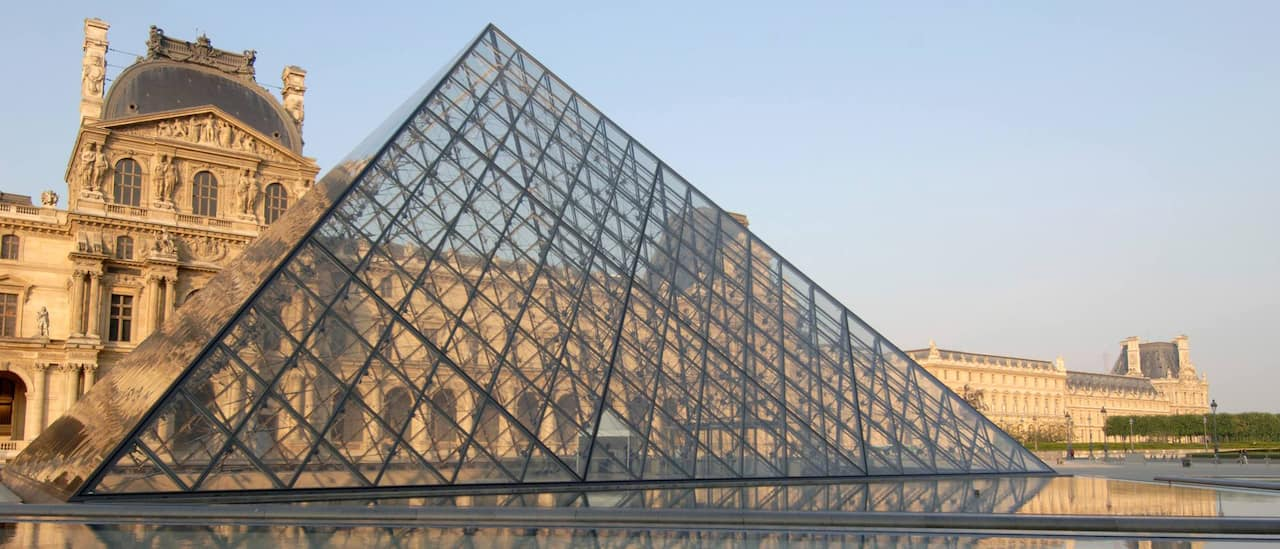 A glass pyramid in front of the Louvre Museum in Paris, France.