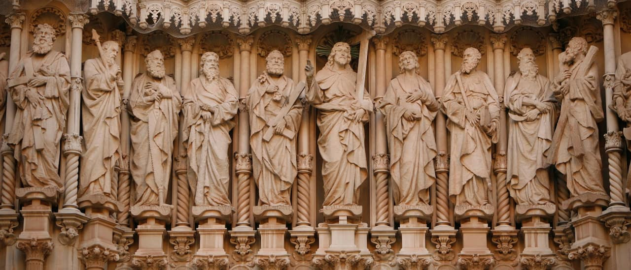 Statues of Jesus and his disciples on the exterior of a building