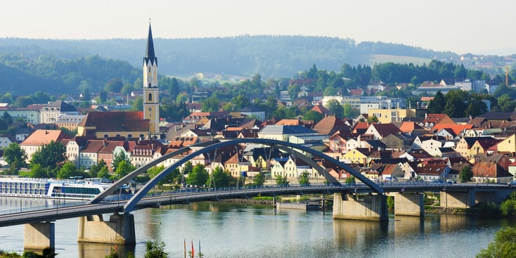 A bridge over the Danube River leads to a quaint town