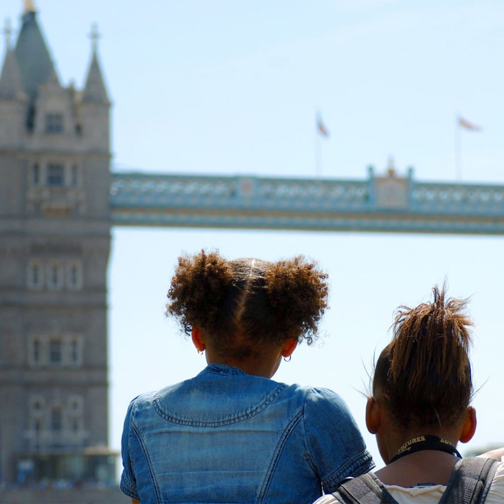 Two girls look at Tower Bridge