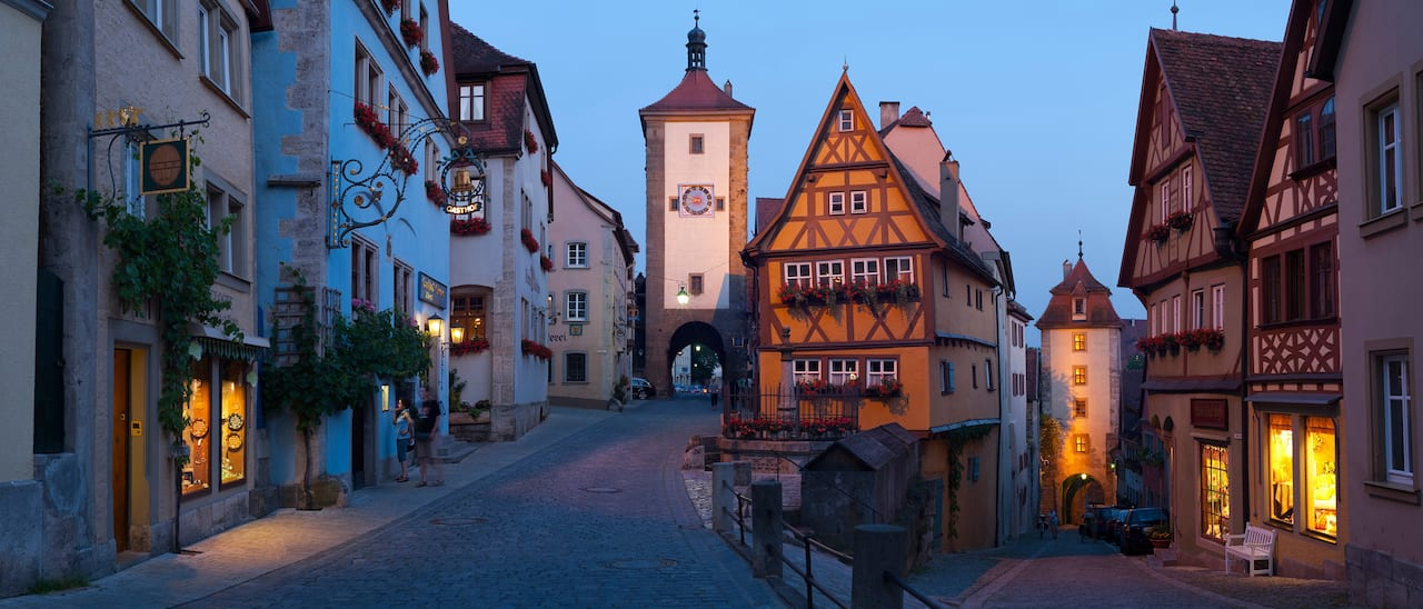 A town with cobblestone streets and storybook style stores