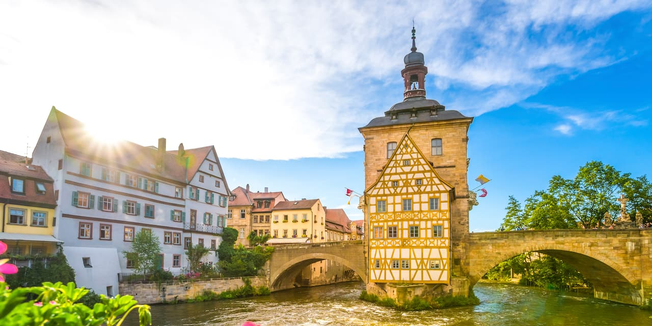 The Old Town Hall in Bamberg with the Regnitz River flowing under its bridge