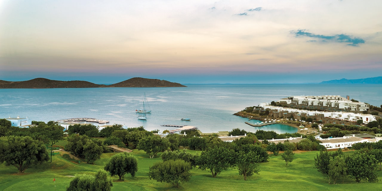 A lush, seaside golf course and resort on a beach in Crete