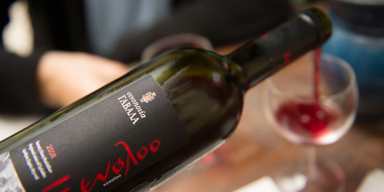 A Greek wine is being poured into a wine glass