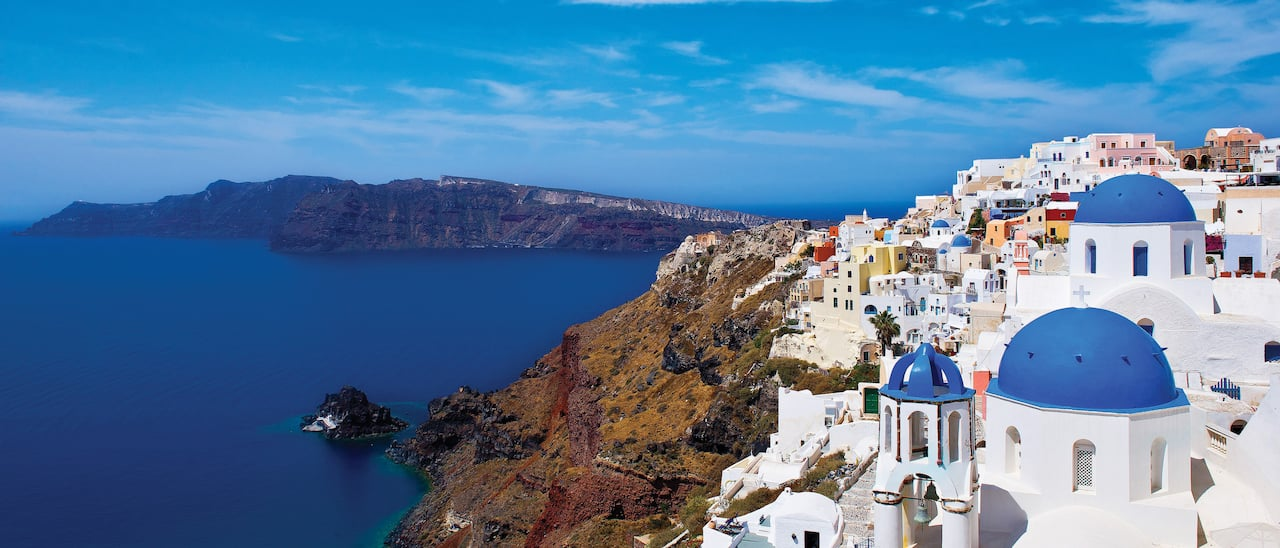 Bask in the tranquility and blue domes of Santorini