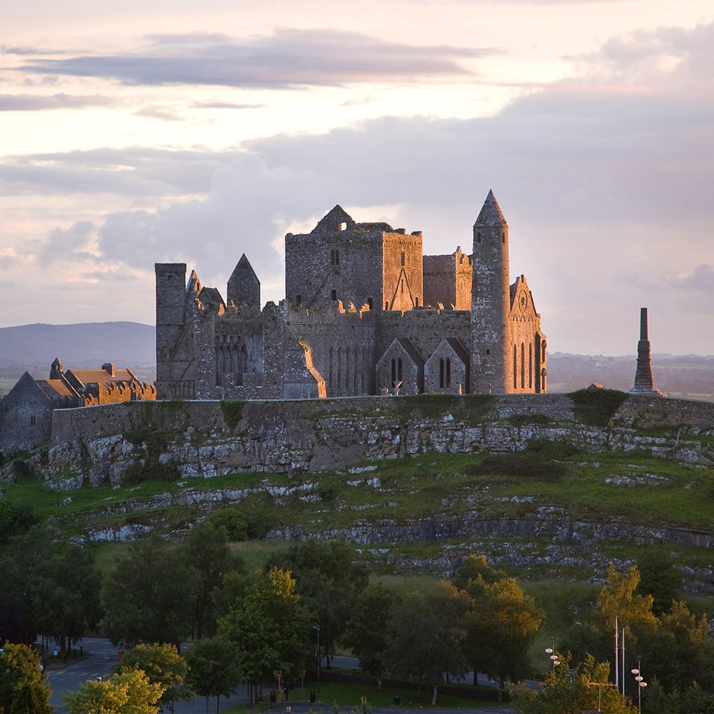 The Rock of Cashel composed of medieval buildings with towers, gables and turreted walls
