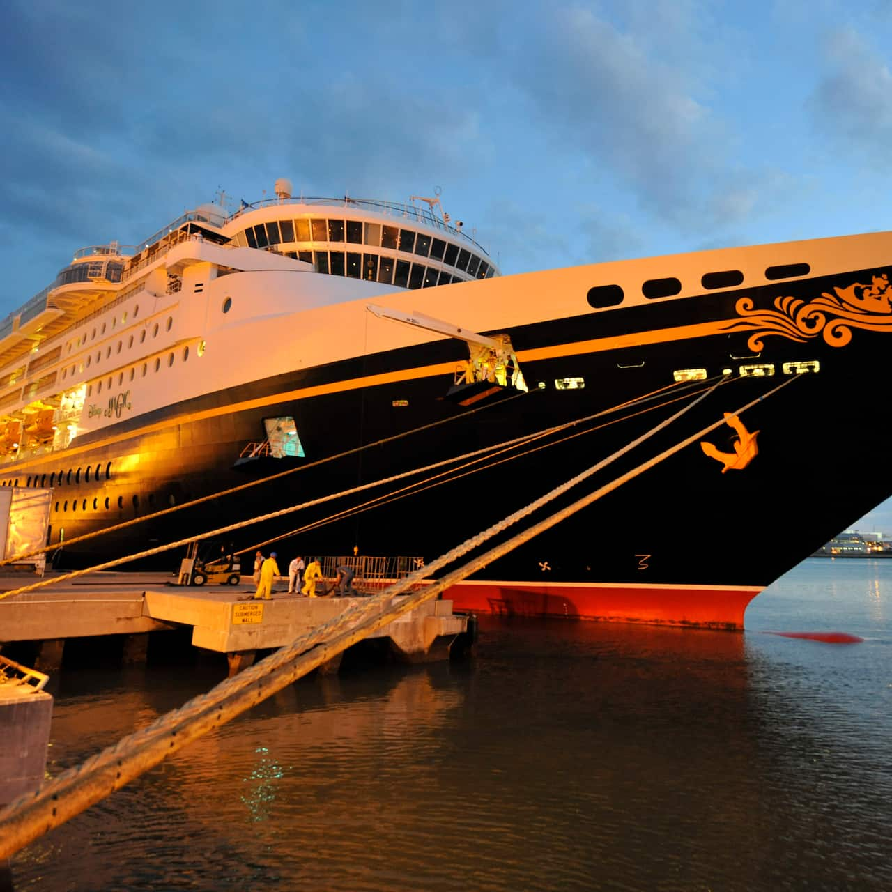 The bow of the Disney Magic cruise ship tethered to a dock