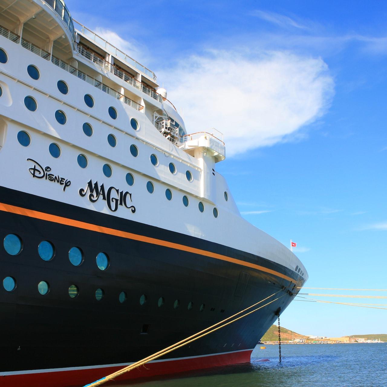 The Disney Magic cruise ship at anchor of a Mediterranean coastline