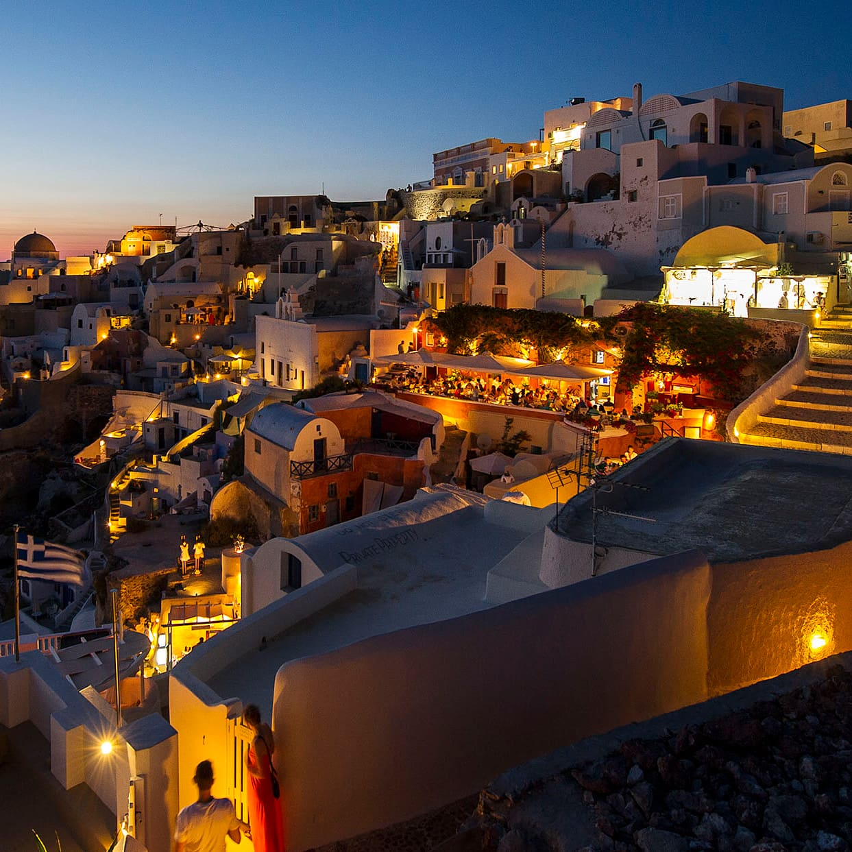 The buildings of the city of Santorini, Greece lit up at nighttime