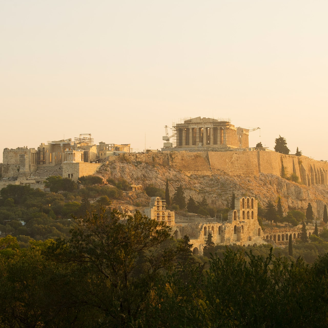 The Parthenon sits atop the Acropolis overlooking the city of Athens, Greece