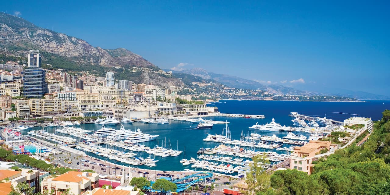 Ships fill the horseshoe-shaped harbor of Monaco which leads out to the Mediterranean Sea