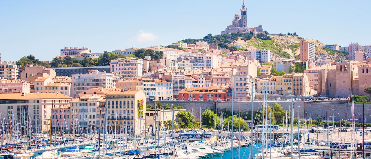The Notre-Dame de la Garde sits on a hill high above Marseilles and its yach marina
