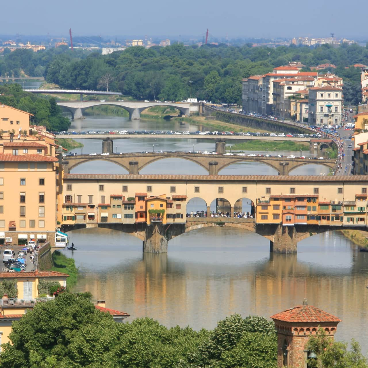 The Ponte Vecchio Bridge spans the Arno River along with several other bridges behind it