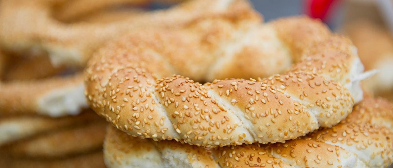 Two stacks of braided greek sesame bread