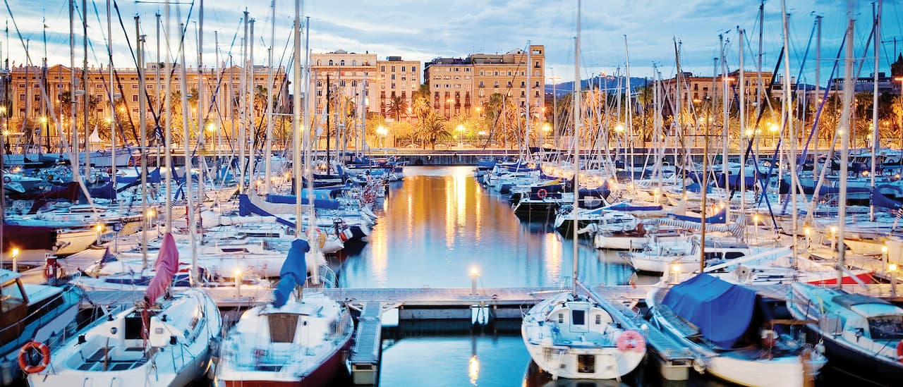 Dozens of boats docked in a Barcelona harbor