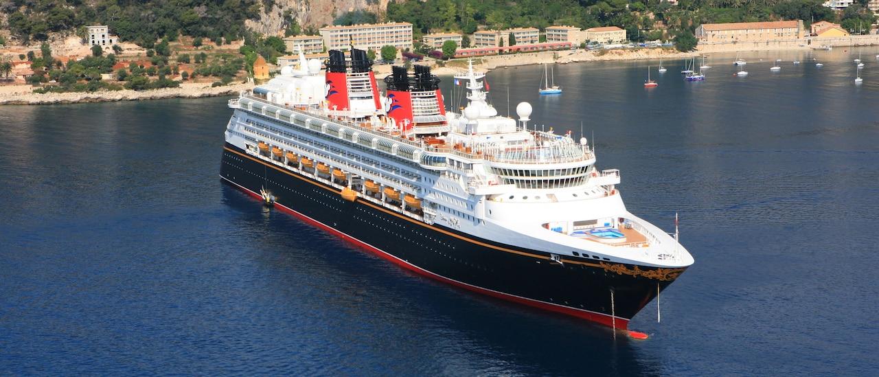 The Disney Magic cruise ship in a harbor