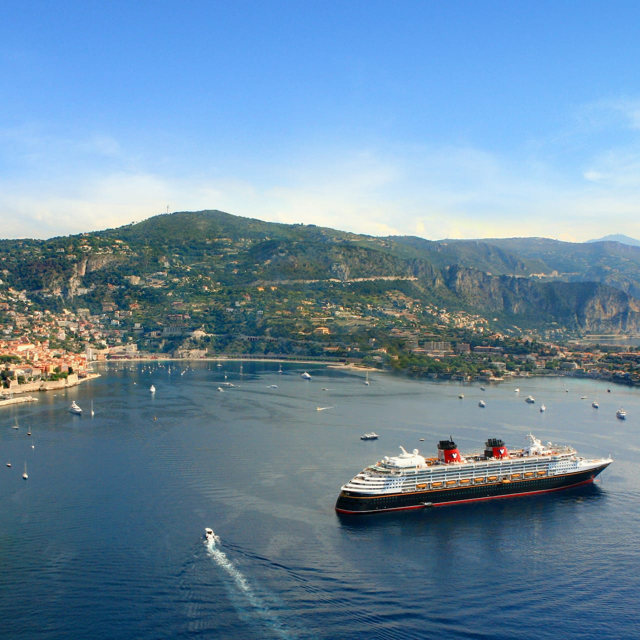 The Disney Magic cruise ship anchored in a bay