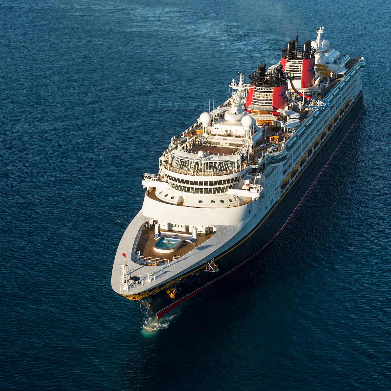 An aerial view of the Disney Magic cruise ship at sea
