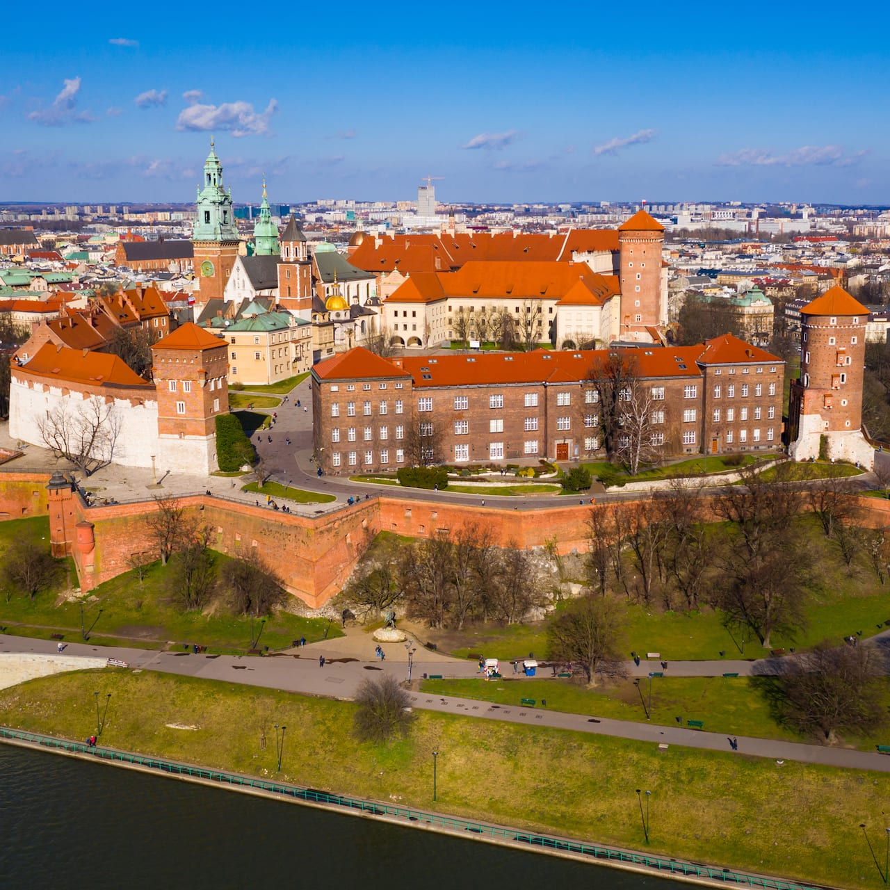 Wawel Castle on a hill, surrounded by the city of Krakow