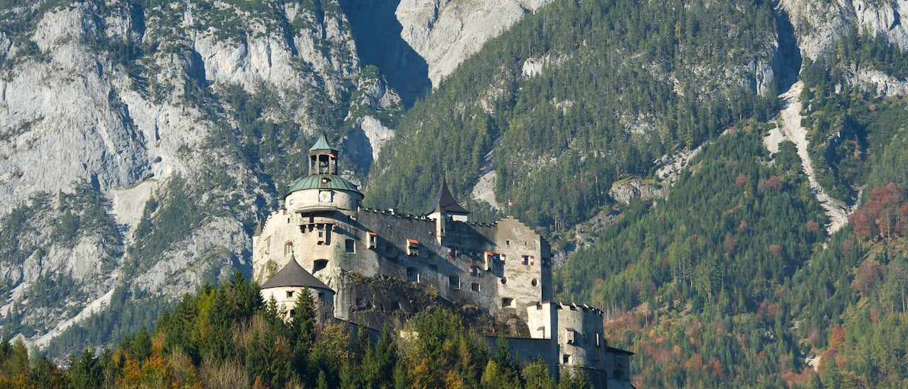Austria's Hohenwerfen Castle surrounded by mountains and a valley below