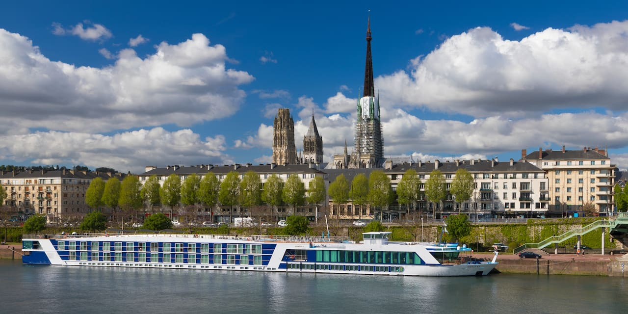 The AmaLyra ship sails past Rouen, France along the Seine River