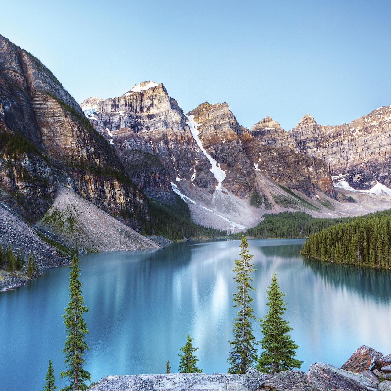 Moraine Lake flows through the glacial mountain peaks of Banff National Park