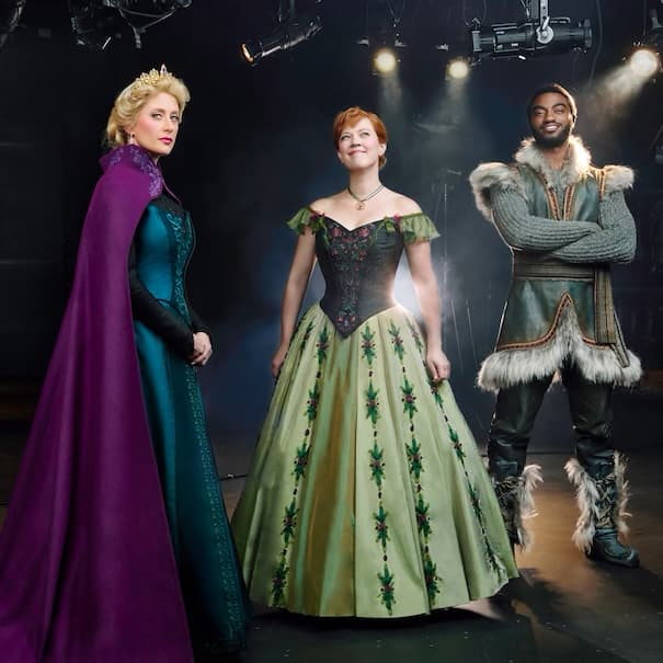 The cast members who portray Hans, Queen Elsa, Princess Anna and Kristoff stand on stage
