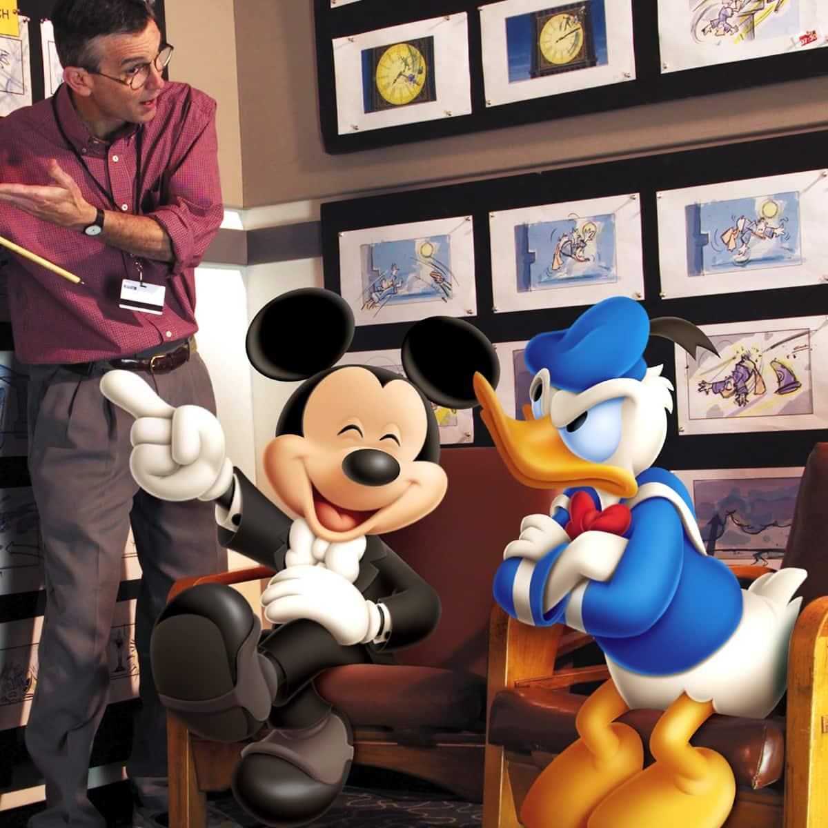 A Cast Member with a pointer shows an animated Mickey Mouse and Donald Duck a series of story boards